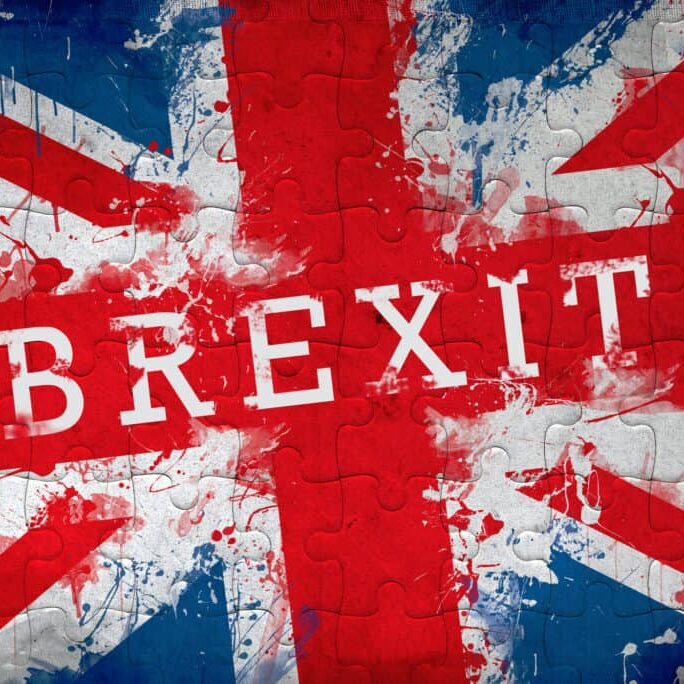 Brexit jigsaw puzzle concept with Great Britain flag